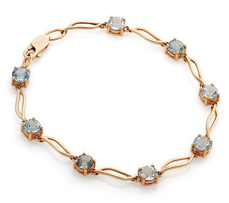 Фото«GZ-2531»Золотой браслет с голубыми топазами